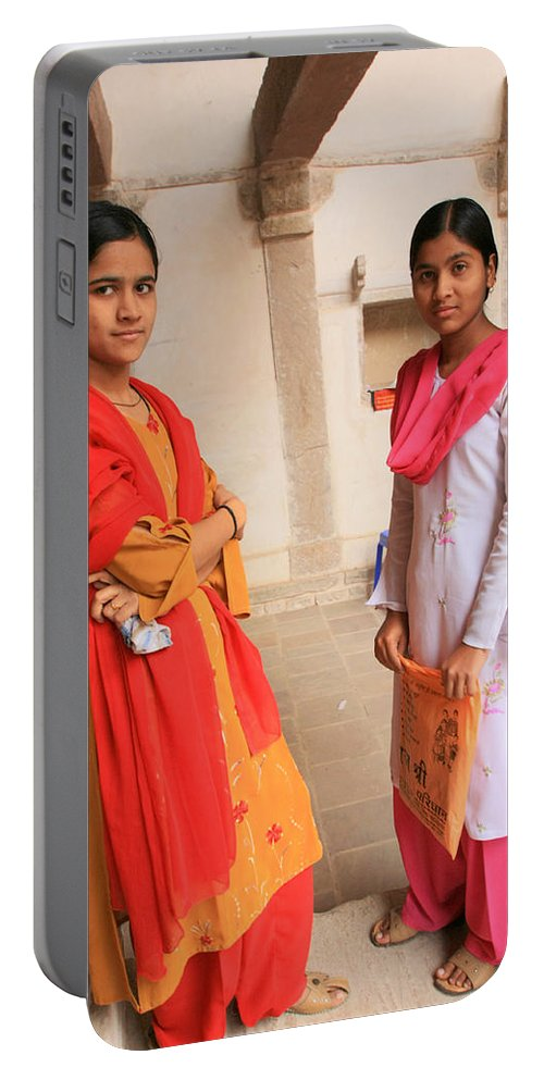 Street Photography Portable Battery Charger featuring the photograph Indian Sewing Students by Amanda Stadther