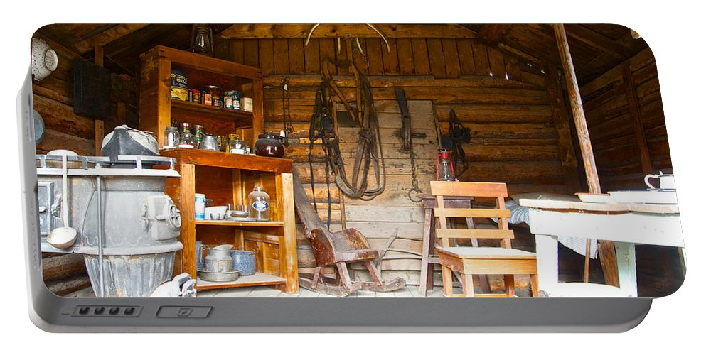 Inside The Real Sam Mcgee's Cabin Portable Battery Charger featuring the photograph Inside The Real Sam Mcgee's Cabin In Macbride Museum In Whitehorse-yk by Ruth Hager