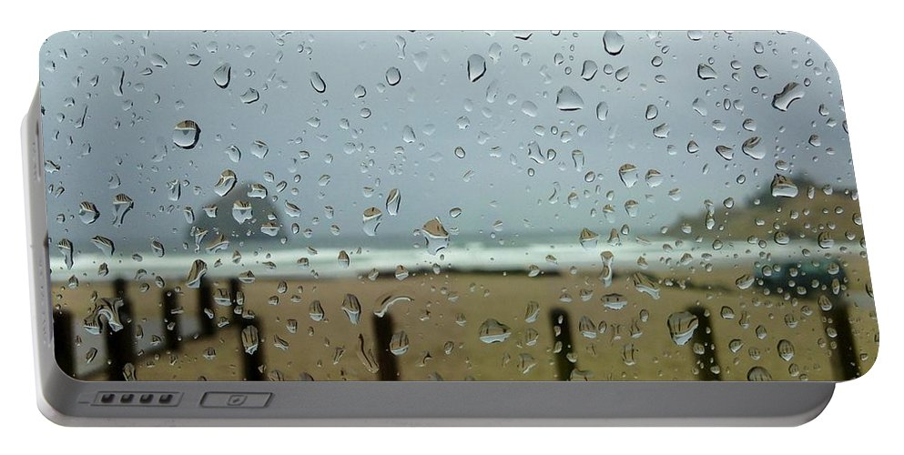 Rainy Day At The Beach Portable Battery Charger featuring the photograph Inside Warmth by Susan Garren