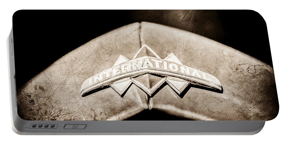 International Grille Emblem Portable Battery Charger featuring the photograph International Grille Emblem -0741s by Jill Reger