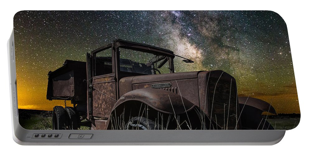 Portable Battery Charger featuring the photograph International Milky Way by Aaron J Groen