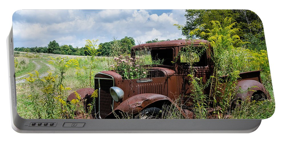 Rusty Truck Portable Battery Charger featuring the photograph Recycled Planter by Georgette Grossman