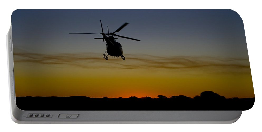 Eurocopter As350 B3 Portable Battery Charger featuring the photograph Into The Sunset II by Paul Job