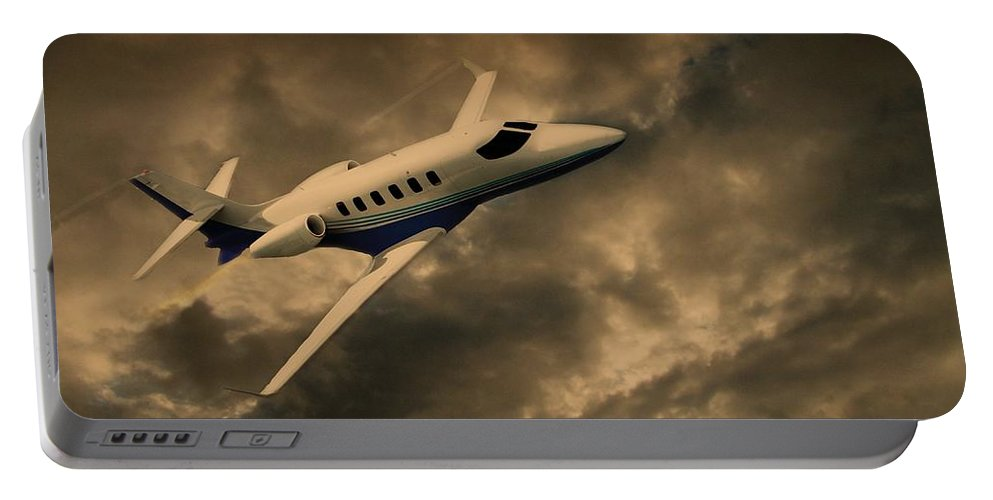 Jet Portable Battery Charger featuring the photograph Jet Through The Clouds by David Dehner