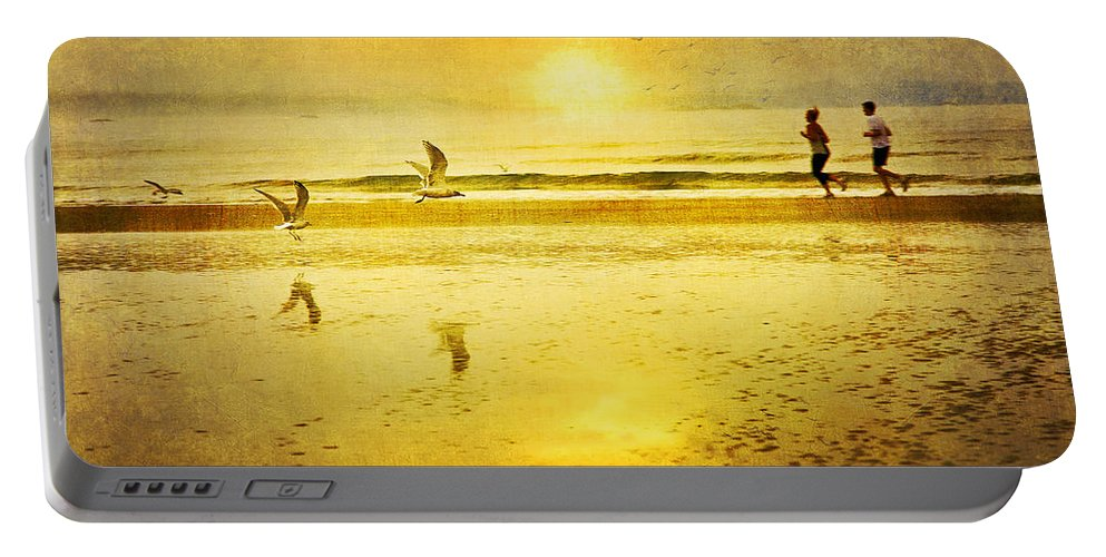 Beach Portable Battery Charger featuring the photograph Jogging On Beach With Gulls by Theresa Tahara