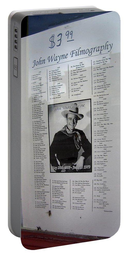 John Wayne's Filmography Bird Cage Theater Tombstone Arizona Portable Battery Charger featuring the photograph John Wayne's Filmography Bird Cage Theater Tombstone Arizona 2004 by David Lee Guss
