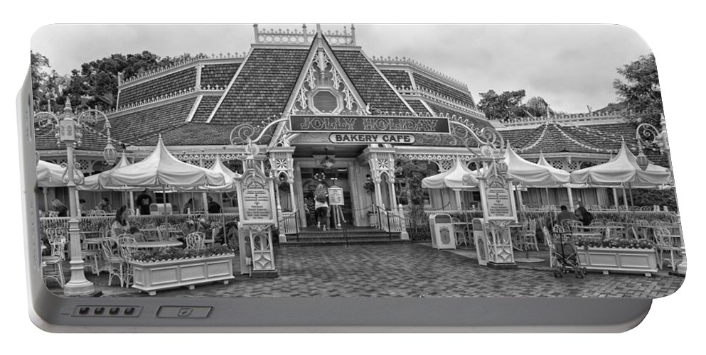 Disney Portable Battery Charger featuring the photograph Jolly Holiday Cafe Main Street Disneyland Bw by Thomas Woolworth