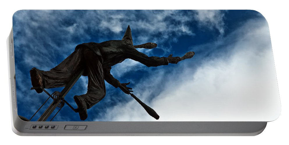 Blue Portable Battery Charger featuring the photograph Juggling Statue by Jess Kraft
