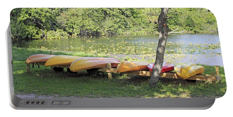 Kayaks Portable Battery Charger featuring the photograph Kayak Rentals by Lee Serenethos