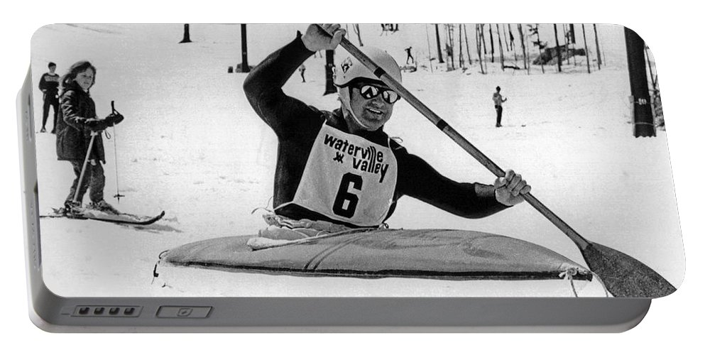 1970s Portable Battery Charger featuring the photograph Kayaking Down The Mountain by Underwood Archives