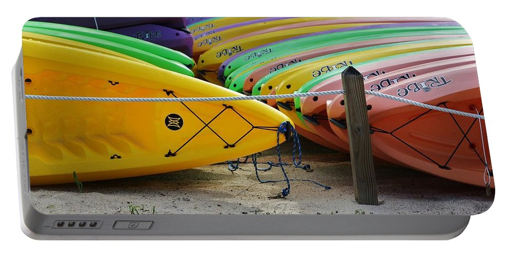 Wet Portable Battery Charger featuring the photograph Kayaks Stacked by Chuck Hicks