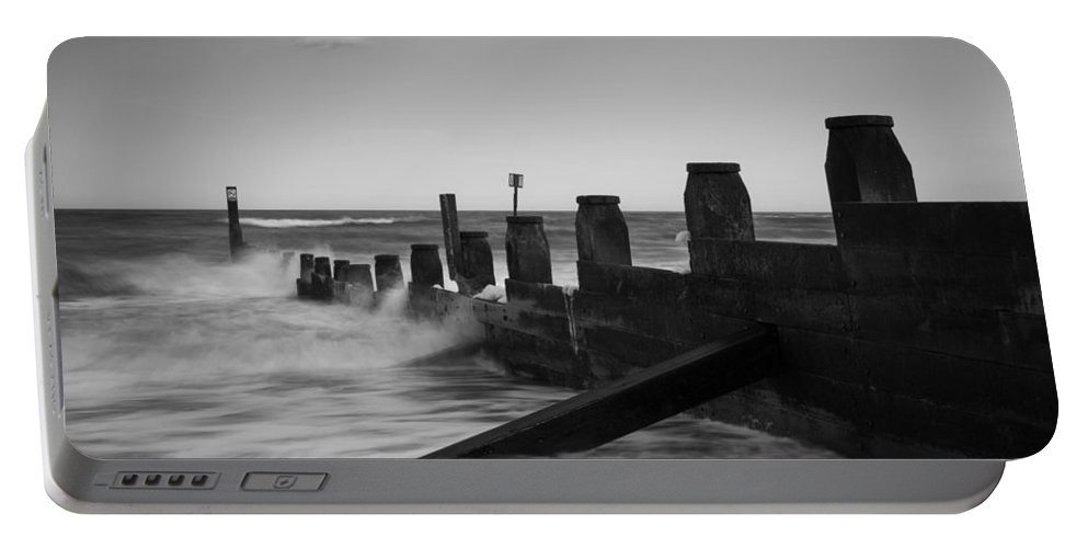 Southwold Portable Battery Charger featuring the photograph Kicked In The Groyne by Dayne Reast