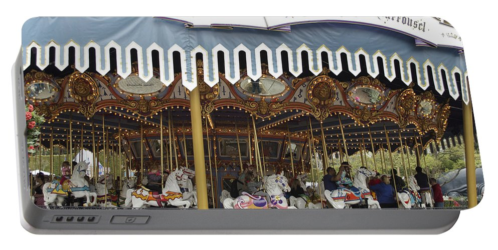 Disney Portable Battery Charger featuring the photograph King Arthur Carrousel Fantasyland Disneyland by Thomas Woolworth