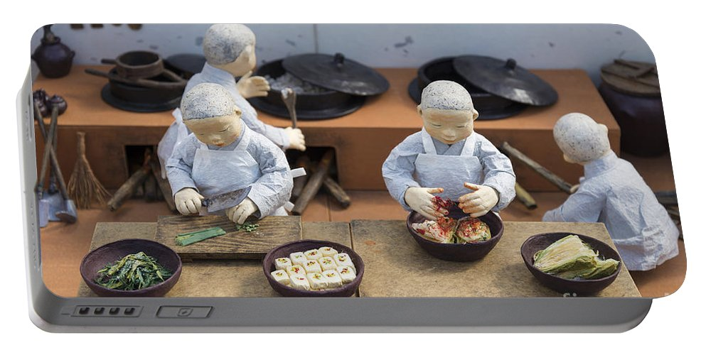 Asian Portable Battery Charger featuring the photograph Korean Monk Figures Preparing Traditional Food by Jacek Malipan