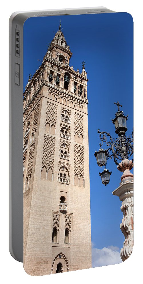 La Portable Battery Charger featuring the photograph La Giralda Cathedral Tower In Seville by Artur Bogacki
