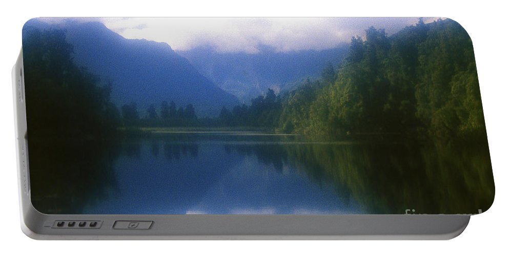 Landscape Portable Battery Charger featuring the photograph Lake Matheson In New Zealand's Westland National Park by Alex Cassels