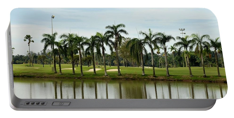 Golf Portable Battery Charger featuring the photograph Lake Sand Traps Palm Trees And Golf Course Singapore by Imran Ahmed