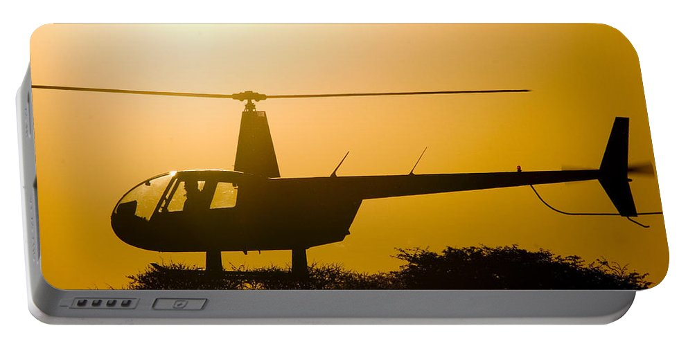 Robinson R44 Raven Ii Portable Battery Charger featuring the photograph Landing On A Tree by Paul Job
