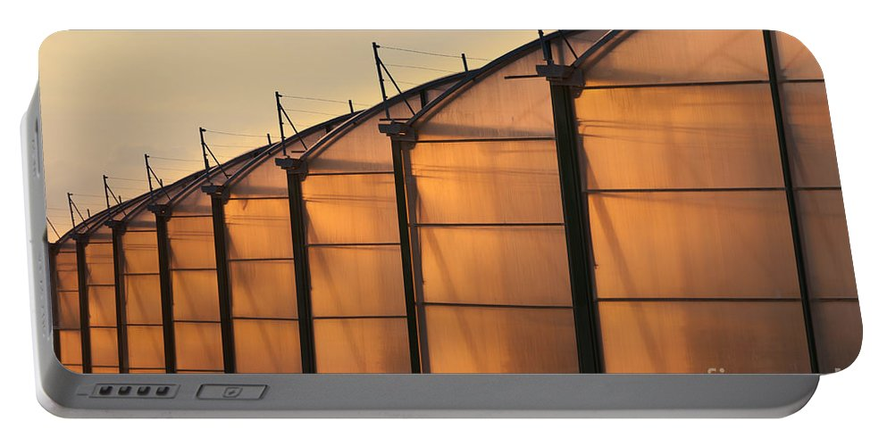 Agri Portable Battery Charger featuring the photograph Large Scale Industrial Greenhouse Lit By Sunet by Stephan Pietzko