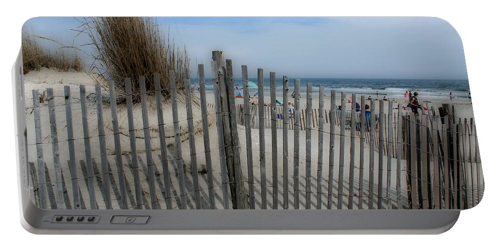 Landscapes Beach Art Sand Art Fence Wood Sky Blue Summertime Ocean Portable Battery Charger featuring the photograph Last summer by Linda Sannuti