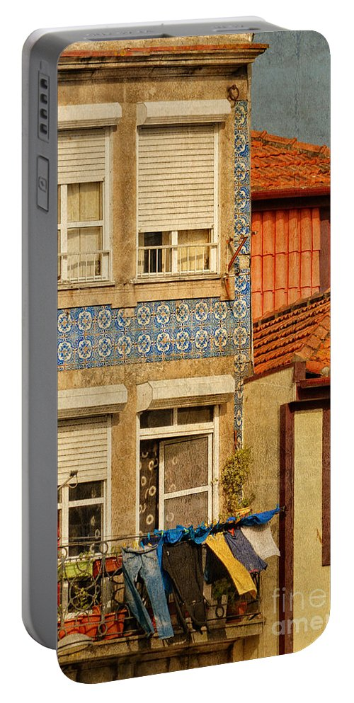 Hot Portable Battery Charger featuring the photograph Laundry Day In Porto - Photo by Mary Machare