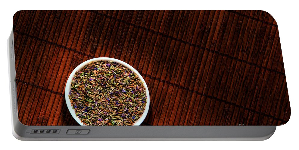 Aromatherapy Portable Battery Charger featuring the photograph Lavender Flower Seeds In Dish by Olivier Le Queinec