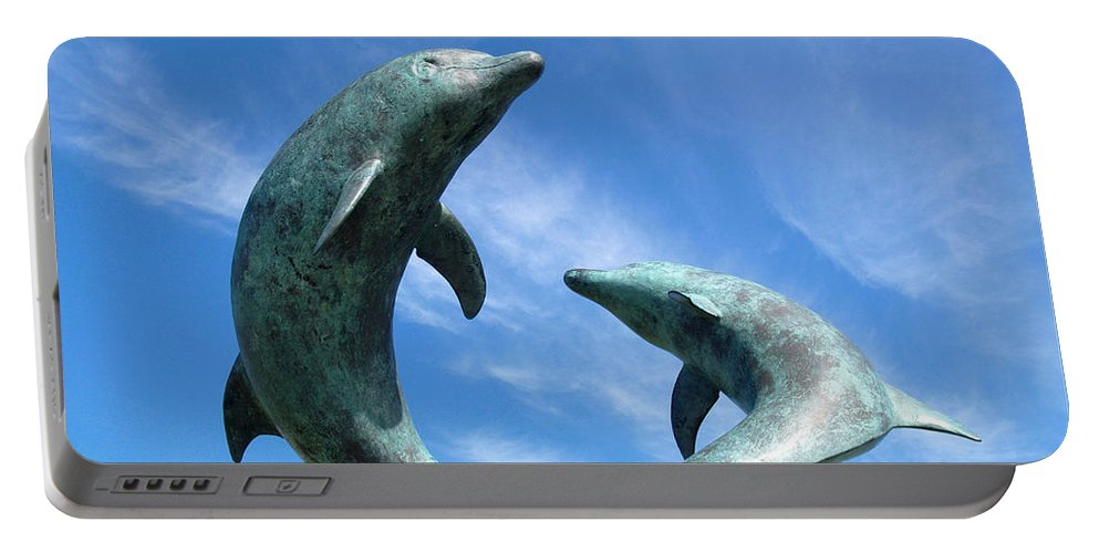 Sculpture Portable Battery Charger featuring the photograph Leaping Dolphins In The Isles Of Scilly by Alex Cassels