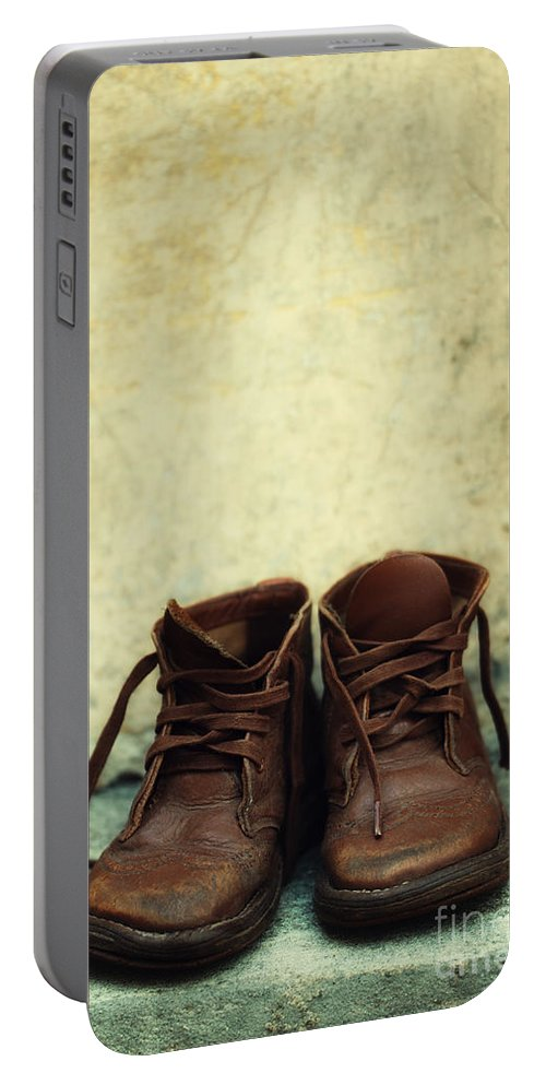 Vertical Portable Battery Charger featuring the photograph Leather Children Boots by Jaroslaw Blaminsky