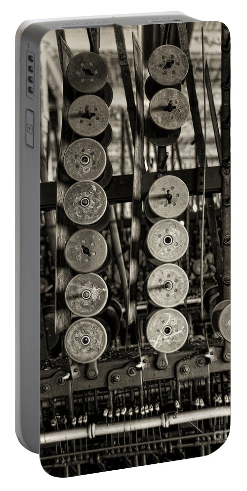 Spools Portable Battery Charger featuring the photograph Left by Claudia Kuhn