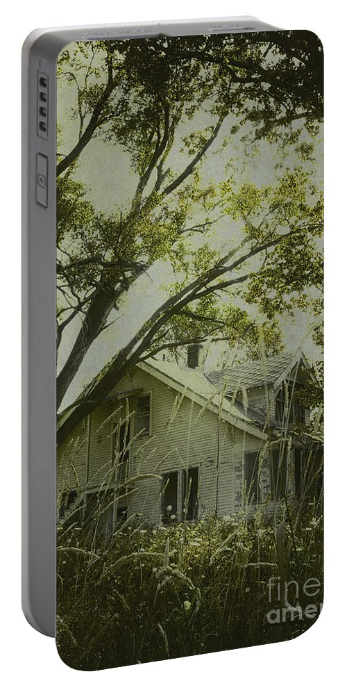 House; Home; Small; Farm House; Wood; Falling Apart; Weeds; Grasses; Trees; Secluded; Abandoned; Desolate; Closed; Dark; Darkness; Ominous; Foreboding; Mystery; Mysterious; Deserted; Shroud; Shrouded; Covered; Enclosed; Green Portable Battery Charger featuring the photograph Left In The Trees by Margie Hurwich