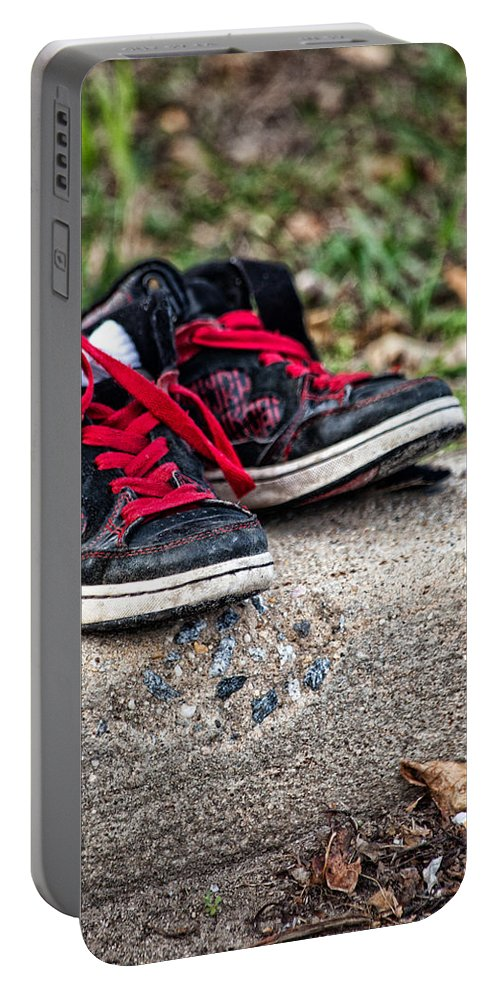 Sneakers Portable Battery Charger featuring the photograph Left On The Curb by Karol Livote