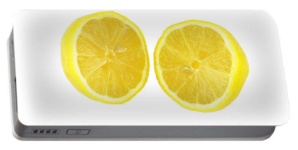 Lemon Portable Battery Charger featuring the photograph Lemon In Halves by Lee Serenethos