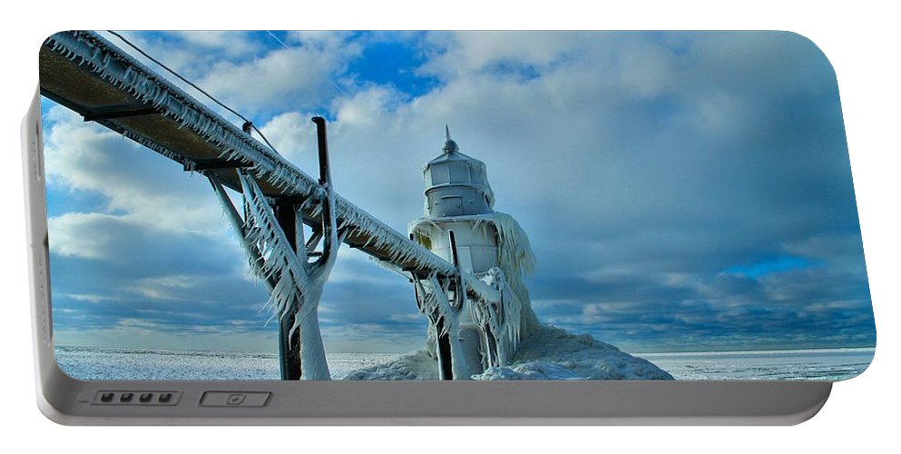 Frozen Lighthouse In Saint Joseph Portable Battery Charger featuring the photograph Lighthouse In Saint Joseph Michigan by Dan Sproul