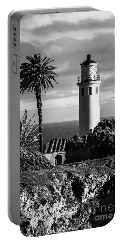 Black And White Photo Portable Battery Charger featuring the photograph Lighthouse On The Bluff by Jerry Cowart