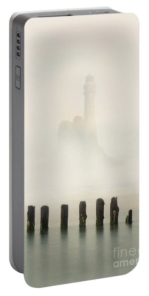 Sky Portable Battery Charger featuring the photograph Lightouse In The Early Fog by Jaroslaw Blaminsky
