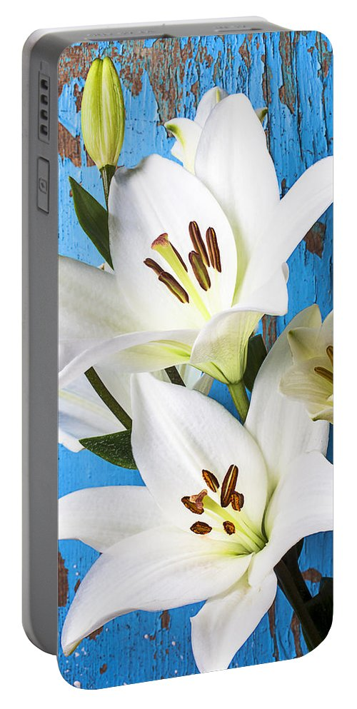 White Lily Portable Battery Charger featuring the photograph Lilies Against Blue Wall by Garry Gay