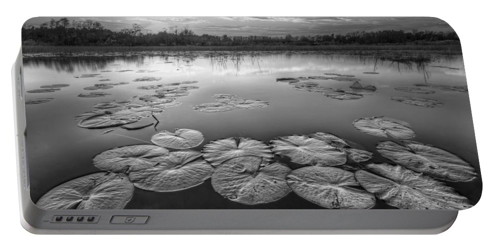 Clouds Portable Battery Charger featuring the photograph Lily Pads In The Glades Black And White by Debra and Dave Vanderlaan