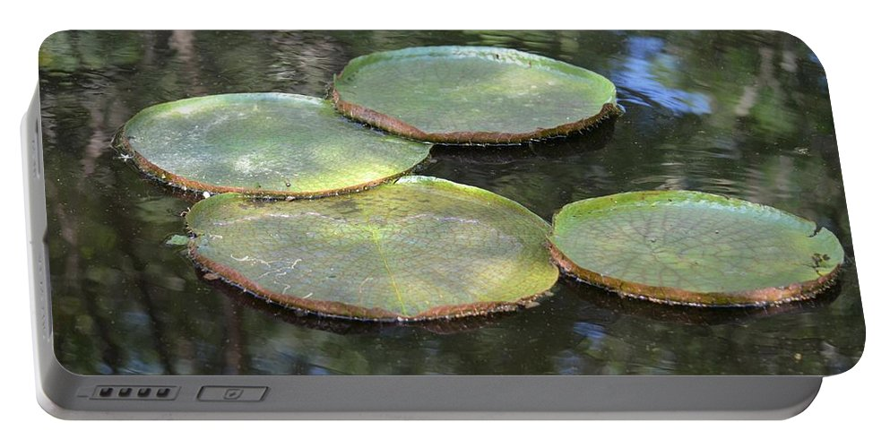 Lilypad Quads Portable Battery Charger featuring the photograph Lilypad Quads by Maria Urso