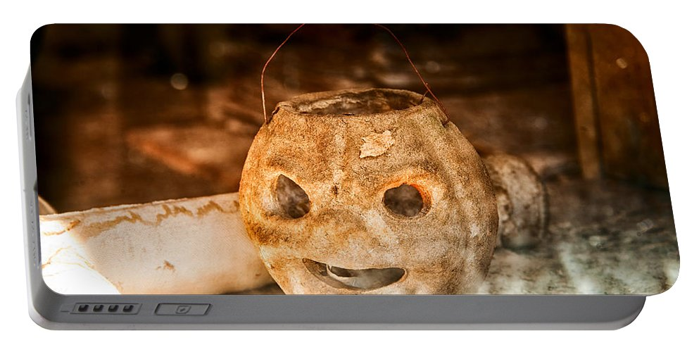 Old Portable Battery Charger featuring the photograph Little Orange Face by Cat Connor