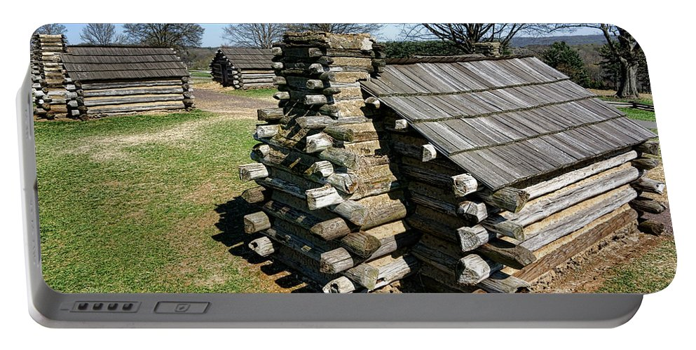 Valley Portable Battery Charger featuring the photograph Log Cabins At Valley Forge by Olivier Le Queinec