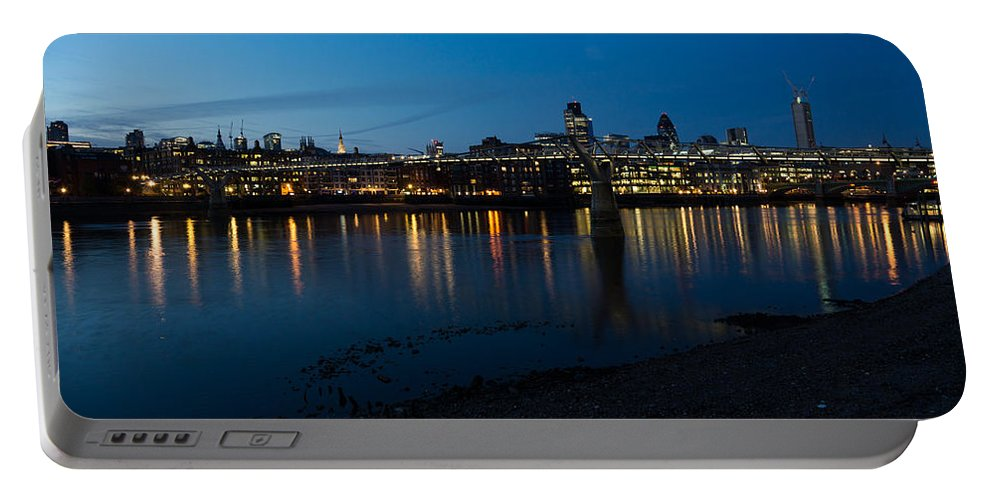 Skyline Portable Battery Charger featuring the photograph London Skyline Reflecting In The Thames River At Night by Georgia Mizuleva