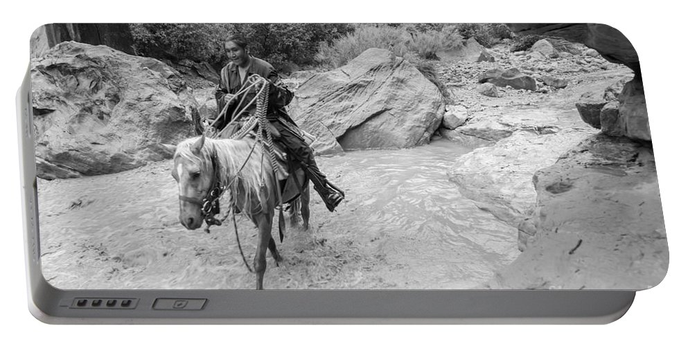 Arizona Portable Battery Charger featuring the photograph Lone Traveller by Nicholas Pappagallo Jr