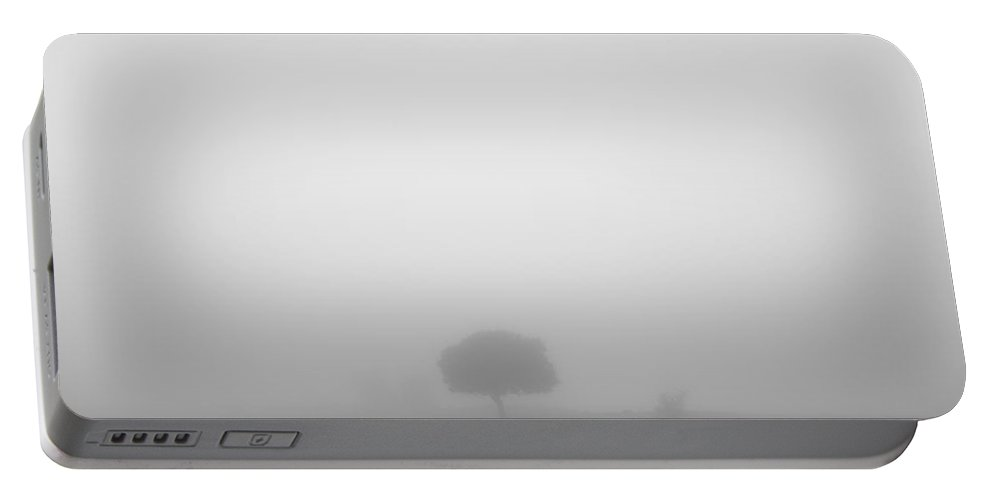 Black And White Portable Battery Charger featuring the photograph Lonely Tree At The Mist by Guido Montanes Castillo