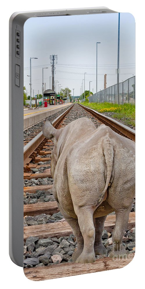 Rhino Portable Battery Charger featuring the photograph Rhino On A Railway Track by Les Palenik