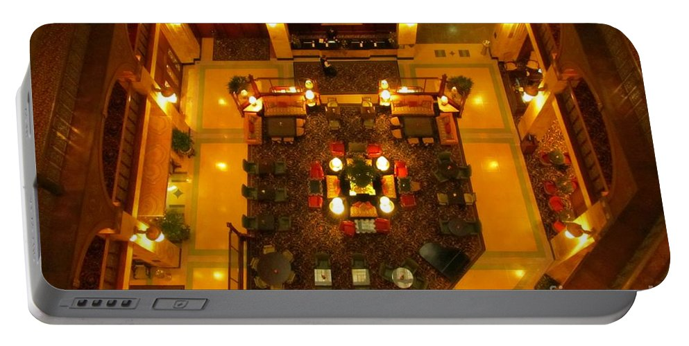 Atrium Art Prints Portable Battery Charger featuring the photograph Looking Down On The Reception Desk by John Malone