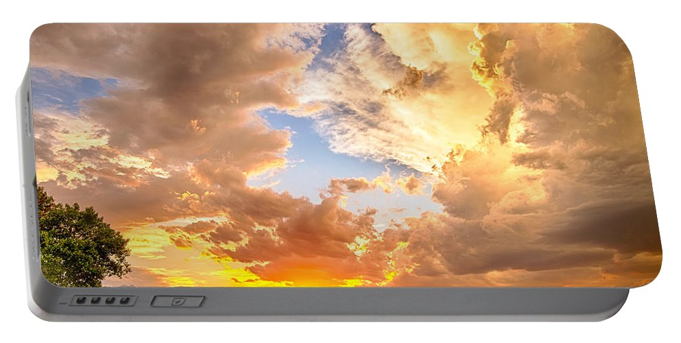 Sunset Portable Battery Charger featuring the photograph Looking Through The Colorful Sunset To Blue by James BO Insogna