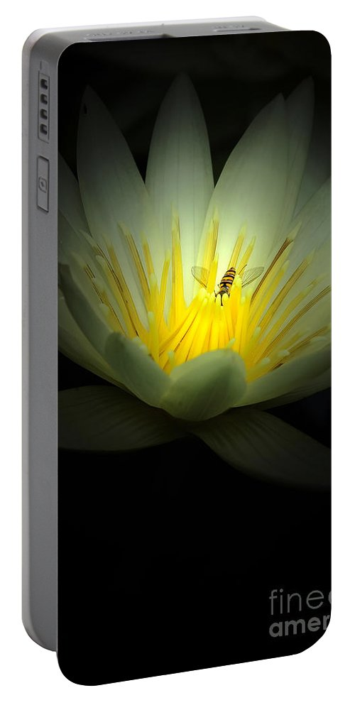 Lotus Portable Battery Charger featuring the photograph Lotus And Bee by Mike Nellums