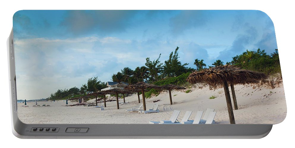 Photography Portable Battery Charger featuring the photograph Lounge Chairs And Parasol On Pink Sands by Panoramic Images