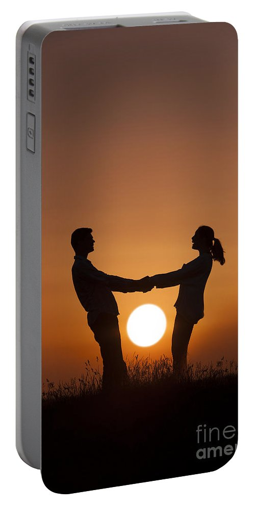 Couple Portable Battery Charger featuring the photograph Lovers And Setting Sun by Lee Avison