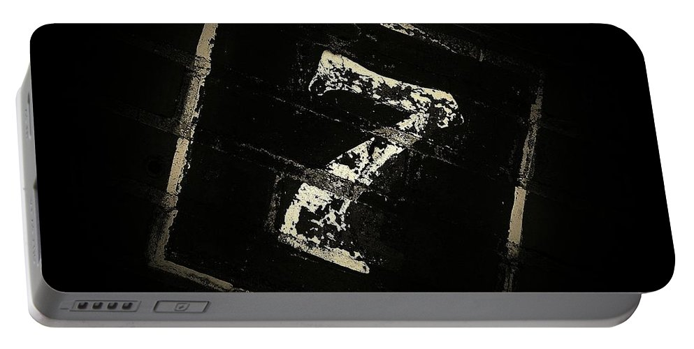 Seven Portable Battery Charger featuring the photograph Lucky Number Seven by Chris Berry
